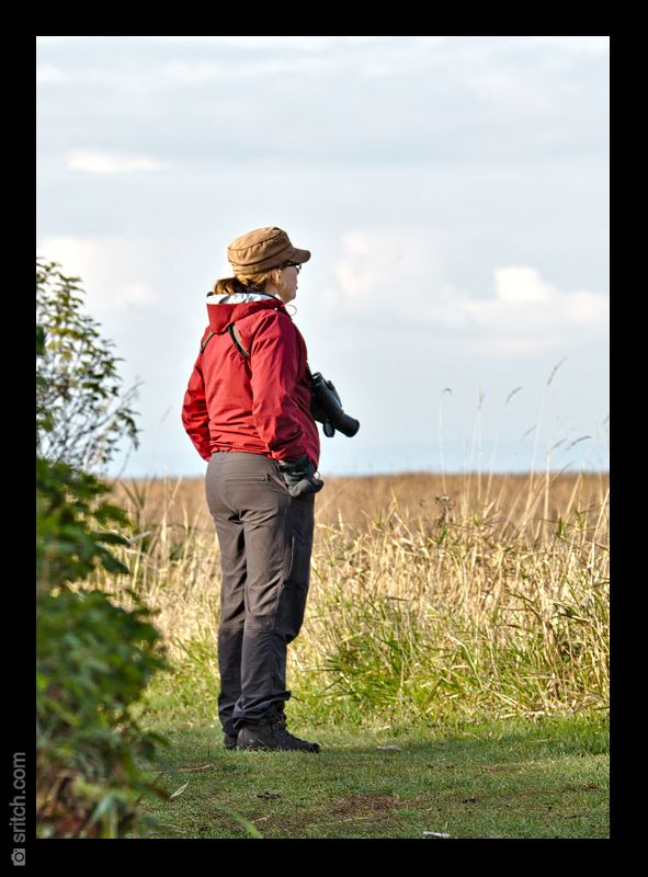 A lady birder with a pair of Zeiss binoculars and a Panasonic FZ150