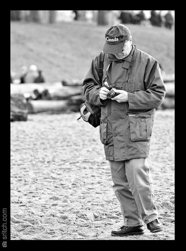 Photographer checking his settings