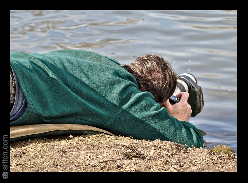 Photographer laying down almost in the water