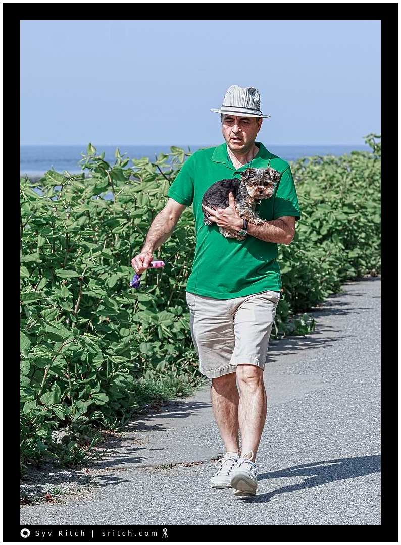 Man carrying his Yorkie