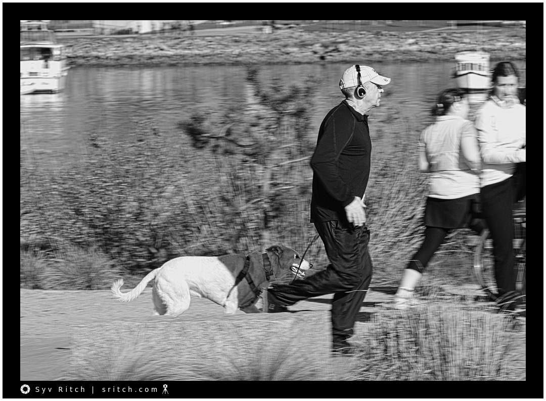 Older man jogging with his dog